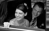 picture of wedding couple  - Bride and groom in black wedding car limousine - JPG