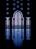 Blue Reflections Thru Glass Windows Framing Door Into Mosque