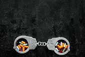 Arrest For Illegal Purchase, Possession And Sale Drugs Concept. Drugs As Pills Near Handcuff On Blac poster