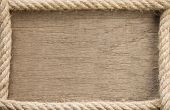 ship rope and copy space wooden background