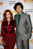 LOS ANGELES - DEC 4:  Christina Hendricks, Geoffrey Arend arrives at