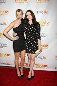 LOS ANGELES - DEC 4:  Beth Behrs, Kat Dennings arrives at