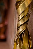 Brass Wire On A Copper Background. Close-up. Close-up Of Recycled Brass poster