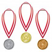 Three medals in gold, silver, and bronze with red and white ribbons; perfect for projects! (