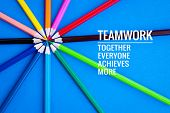 Teamwork Concept. Group Of Color Pencil On Blue Background With Word Teamwork, Together, Everyone, A poster