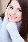 stock photo of blue eyes  - Portrait of a young cute woman in warm sweater - JPG