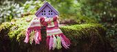 Toy House Is Wrapped In A Warm Scarf. The Concept Is Warm, Cozy, Loving, Protecting The House. We Pr poster