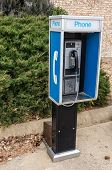 Pay Phone On A Sidewalk