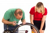A Mechanic Repairs The Wheel Of A Bicycle