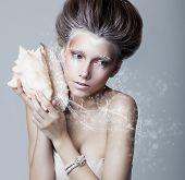 Sea Shell. Beauty Woman Painted Face. Creative Makeup