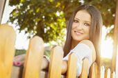 Beautiful young woman enjoying autumn in park