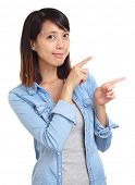 Asian woman pointing a side