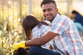 foto of pick up  - handsome teen volunteer cleaning streets with friends - JPG