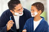 foto of shaving  - playful father and son shaving together at home bathroom - JPG