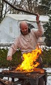 The Blacksmith Working