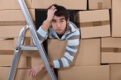 stock photo of ladder truck  - Stressed young factory worker - JPG