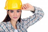 Woman touching the brim of her hard hat
