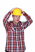 Shocked construction worker