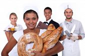 young bakery sales girl and staff of food and catering industry