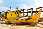 Yellow fishing boat, damaged