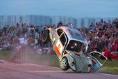 MOSCOW - AUG 25: The car landed after jumping from the springboard on Festival of art and film stunt