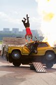 MOSCOW - AUG 25: Stuntman flies over the burning car on Festival of art and film stunt Prometheus in