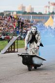 MOSCOW - AUG 25: Cheerful clown rides in a bath on Festival of art and film stunt Prometheus in Tush