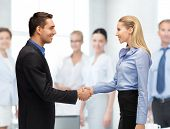 bright picture of man and woman shaking their hands