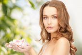 picture of beautiful woman with rose petals