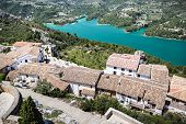Guadalest lake and village. Reservoir and tiling roofs. Photo.