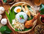 Nasi kerabu is a type of nasi ulam, popular Malay rice dish. Blue color of rice resulting from the p