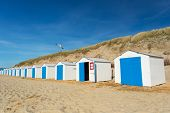 Row blue and white beach cabins for vacation surpose