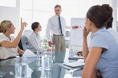 Businesswoman asking something during a meeting in the meeting room
