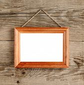 Photo Frame Hanging On Old Wooden Wall