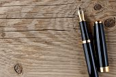 Fountain Pen On Old Wooden Background