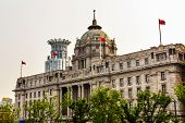 foto of hsbc  - HSBC Building now used by a Chinese Bank The Bund Old Part Shanghai China with Flags - JPG