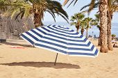 Striped umbrella on the Teresitas beach of Tenerife island. Canaries