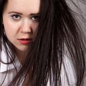 Disheveled Long-haired Woman In A White Men's Shirt