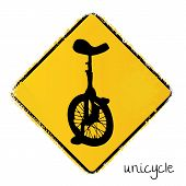 warning road sign with a unicycle