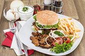 Kebab Burger With Chips On Wood