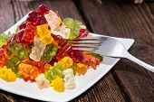 stock photo of jelly babies sugar  - Gummi Bears on a plate as meal with fork  - JPG