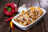 foto of nachos  - Nachos with Chili con Carne gratinated with cheese - JPG