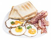 Fried Eggs And Bacon Isolated On White