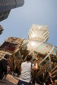 MACAU, CHINA - NOVEMBER 2, 2012: Tourists at the Grand Lisboa Casino - one of the largest and popula