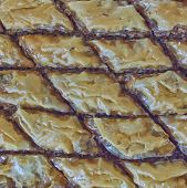foto of phyllo dough  - delicious baklava traditional midle east desert with nuts and honey syrup - JPG