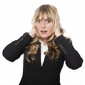 Woman Covering Her Ears With A Shocked Expression