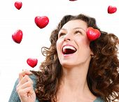Beauty Young Woman Catching Valentine Hearts. Love Concept. Beautiful Joyful Girl Laughing. Valentin