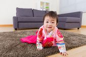 Korean baby with traditional costume crawling on carpet