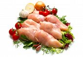 Raw Chicken Fillets Close Up On White