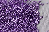 stock photo of beads  - Pile purple balls of bead suitable for Background and texture - JPG